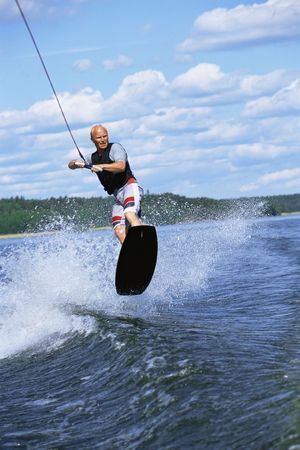 bodyboard: Man waterskiing