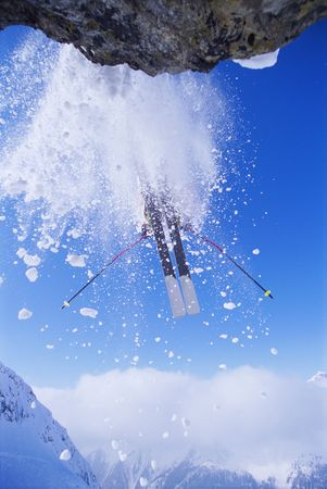 caucasoid race: Skier jumping off snowy cliff Stock Photo