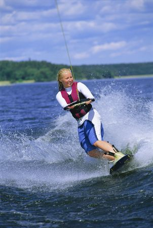 sporting activity: Woman waterskiing Stock Photo