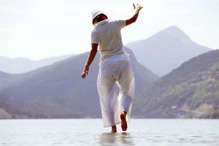 caucasoid race: Woman outdoors walking on water in scenic location