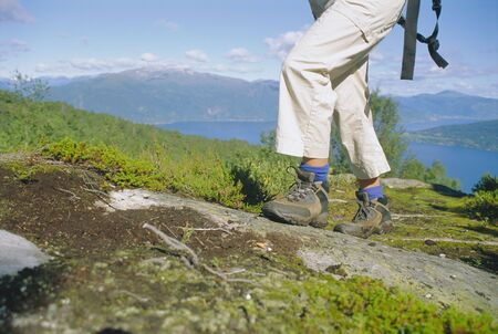 Woman's legs hiking outdoors in scenic location photo