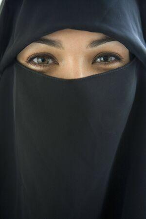 closeups: Woman wearing black veil indoors