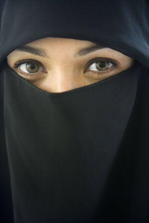 Woman wearing black veil indoors