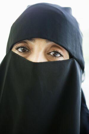 parlours: Woman wearing black veil indoors (high key)