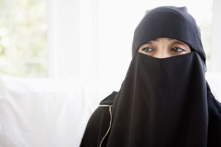 jilaabah: Woman wearing black veil indoors (high key)