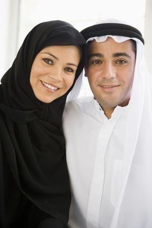 thobes: Couple indoors smiling (high key) Stock Photo