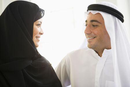 Couple indoors facing each other smiling (high key) Stock Photo - 3186160