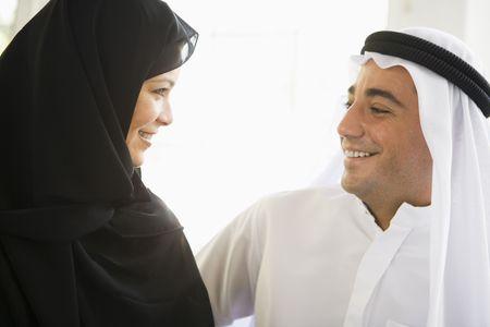 khameez: Couple indoors facing each other smiling (high key)