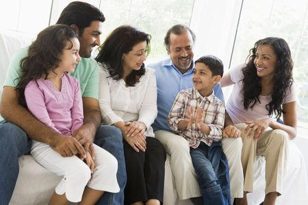 Family sitting in living room smiling (high key) Stock Photo - 3186572