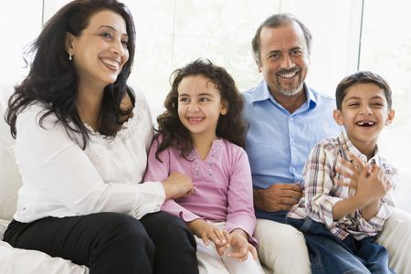 Grandparents sitting in living room with grandchildren smiling (high key) Stock Photo - 3186584