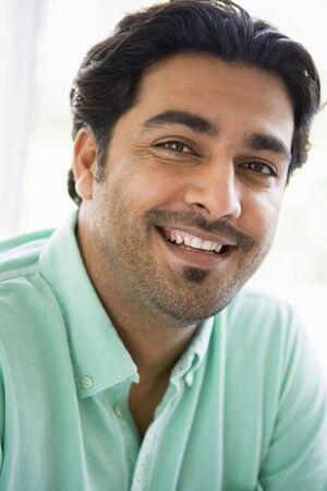Man indoors smiling (high key) photo