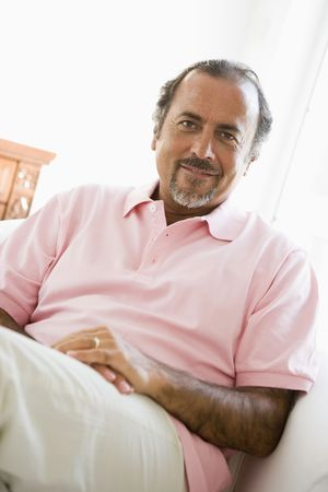 offset angle: Man sitting in living room smiling (high key)