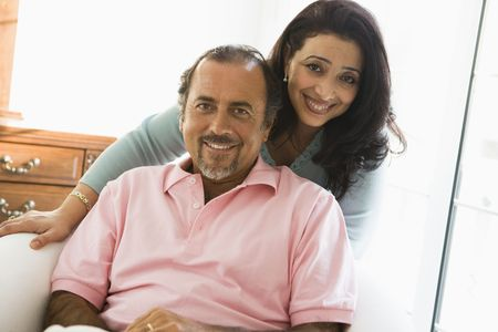 Couple in living room smiling (high key) Stock Photo - 3186682