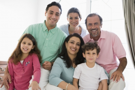 Family sitting in living room smiling (high key) Stock Photo - 3186587