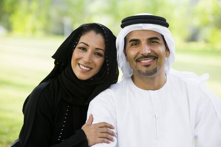 Couple outdoors in park smiling (selective focus) Stock Photo