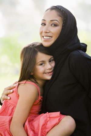 Mother and daughter outdoors in park embracing and smiling (selective focus) Stock Photo - 3186636