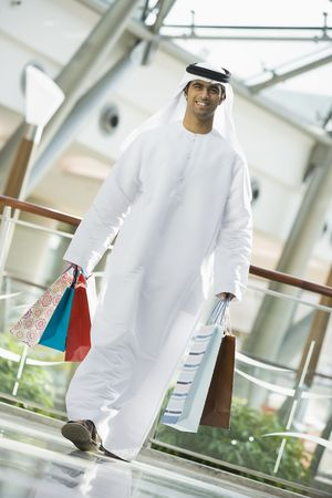 khameez: Man walking in mall smiling (selective focus) Stock Photo
