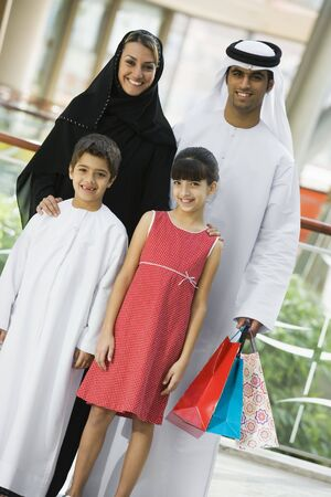 Family standing in mall smiling (selective focus) photo