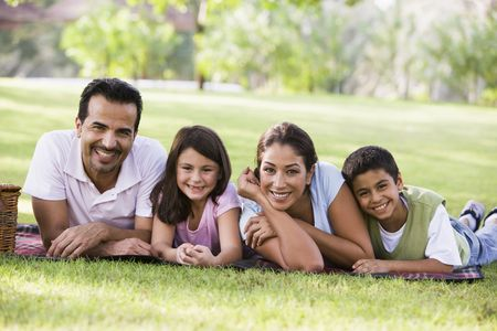 Family outdoors in park with picnic smiling (selective focus) Stock Photo - 3186617