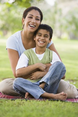 Mother and son outdoors in park bonding and smiling (selective focus) Stock Photo - 3186637