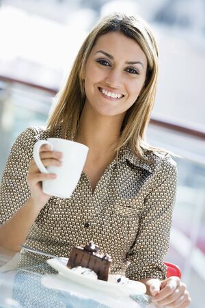 Woman at restaurant eating dessert and smiling (selective focus) Stock Photo - 3186280