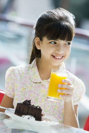 Young girl at restaurant eating dessert and smiling (selective focus) Stock Photo - 3186734