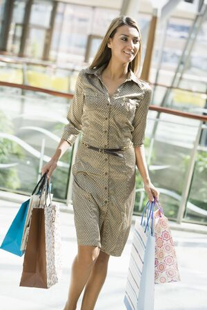 Woman walking in mall smiling (selective focus) Stock Photo