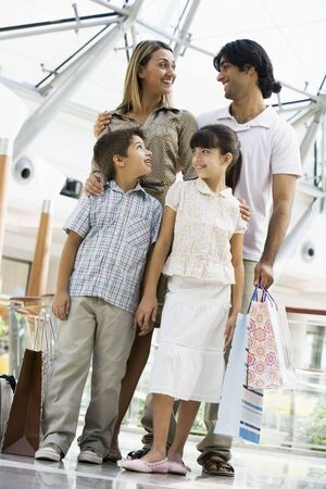 Family standing in mall smiling (selective focus) Stock Photo - 3186566