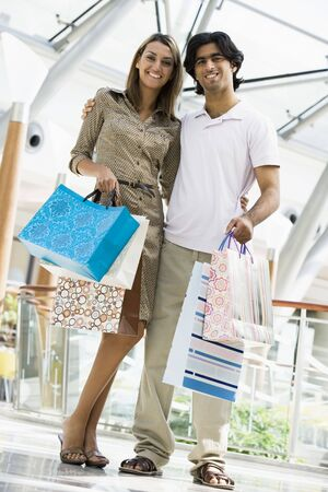 Couple standing in mall smiling (selective focus) Stock Photo - 3186507