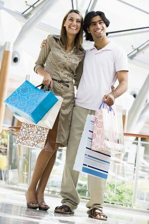 Couple standing in mall smiling (selective focus) Stock Photo - 3186571