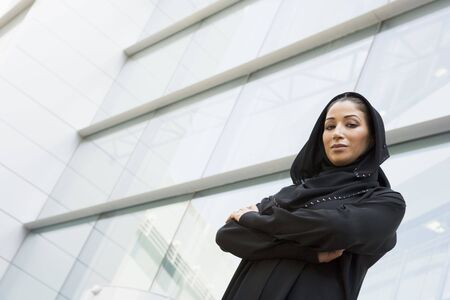 Businesswoman standing outdoors by building (selective focus) Stock Photo - 3170891