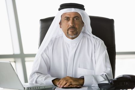 Businessman in office with laptop (high key/selective focus) Stock Photo - 3171722