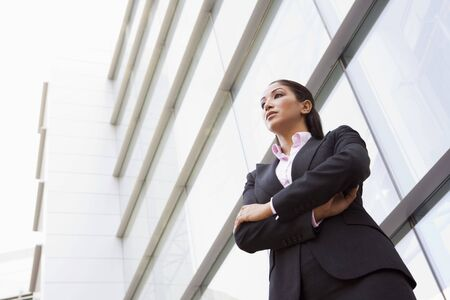 Businesswoman standing outdoors by building (high key/selective focus) Stock Photo - 3171172