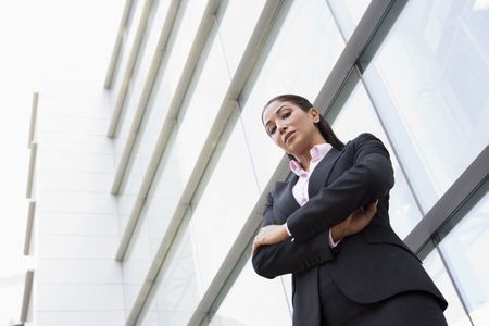 Businesswoman standing outdoors by building (high keyselective focus) photo