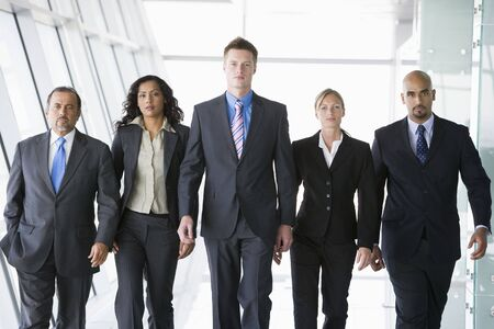 Group of co-workers walking in office space (high key) Stock Photo - 3171009