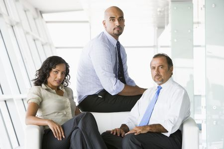 Three businesspeople sitting indoors (high key/selective focus) Stock Photo - 3171742
