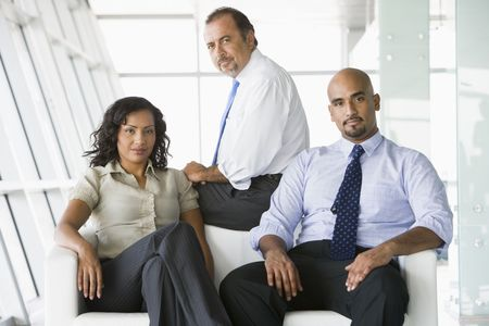 Three businesspeople sitting indoors (high key/selective focus) Stock Photo - 3174427