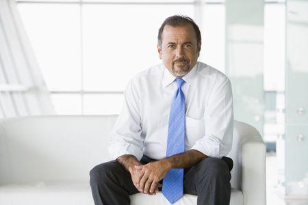 Businessman sitting indoors (high key/selective focus) Stock Photo - 3171729