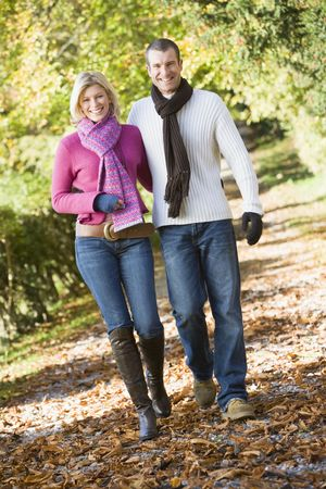 Couple outdoors walking on path in park smiling (selective focus) Stock Photo - 3207909