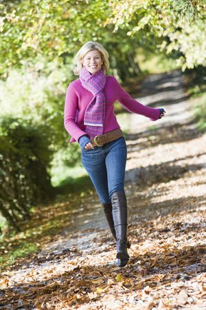 Woman outdoors at park running on path smiling (selective focus) Stock Photo - 3207918