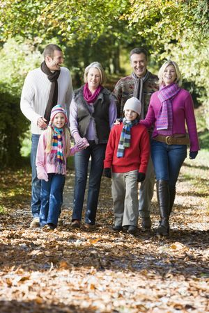 Family walking outdoors in park and smiling Stock Photo - 3207757