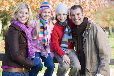 Family outdoors in park smiling (selective focus) Stock Photo - 3217742
