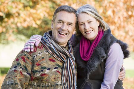 Couple outdoors in park embracing and smiling (selective focus) Stock Photo - 3217928