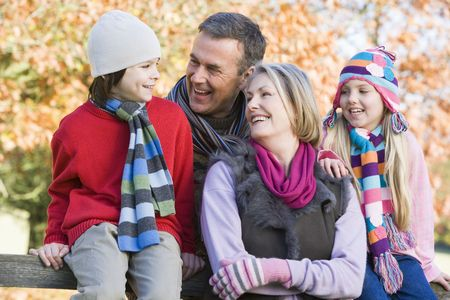 Grandparents with grandchildren outdoors in park smiling (selective focus) Stock Photo - 3217666