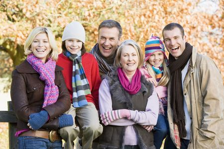 Family outdoors in park smiling (selective focus) Stock Photo