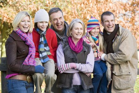 Family outdoors in park smiling (selective focus) Stock Photo - 3207919