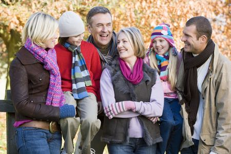 Family outdoors in park smiling (selective focus) Stock Photo - 3207906