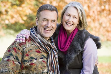 Couple outdoors embracing and smiling (selective focus) Stock Photo - 3217883