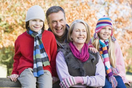 Grandparents with grandchildren outdoors at park smiling (selective focus) Stock Photo - 3207910