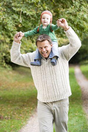 Father giving  son piggyback photo